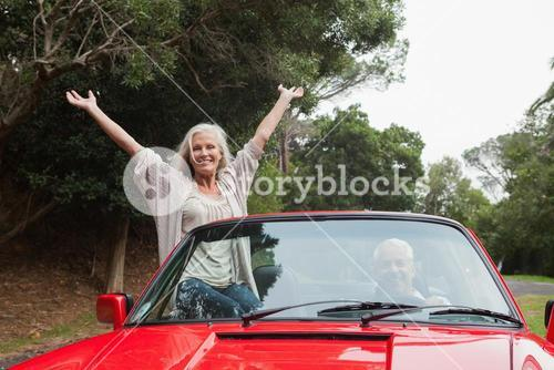 Mature couple having a ride together