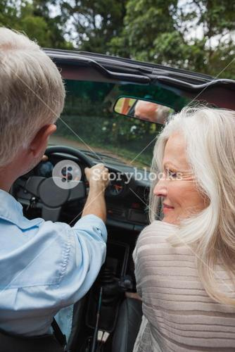 Rear view of happy mature couple going for a ride together