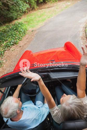 Overhead view of happy mature couple going for a ride together