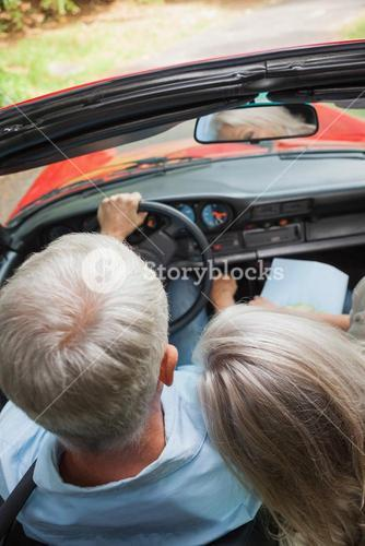 Rear view of mature couple going for a ride