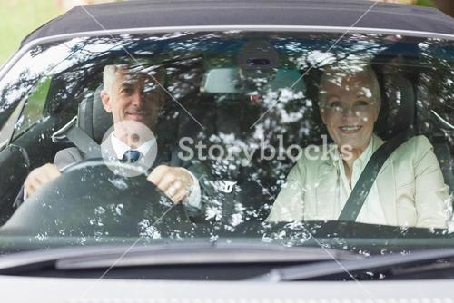 Business people having a ride in classy car