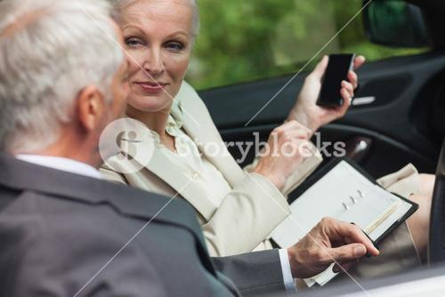 Business people talking together in classy cabriolet