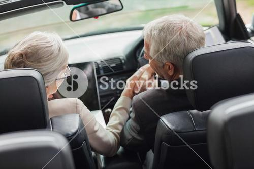 Business people shaking hands in classy convertible