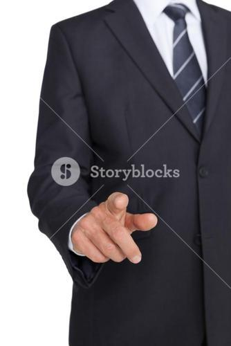 Businessman in suit pointing finger