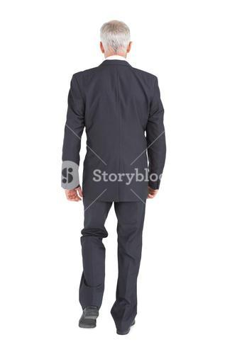 Businessman walking away from camera