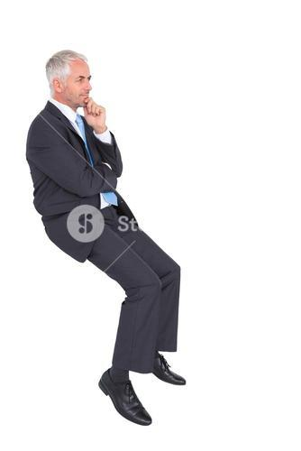 Businessman looking up while thinking