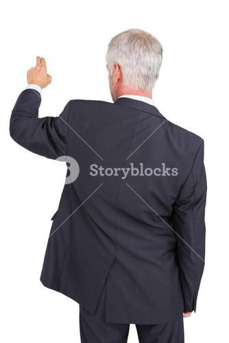 Rear view of stylish mature businessman pointing finger