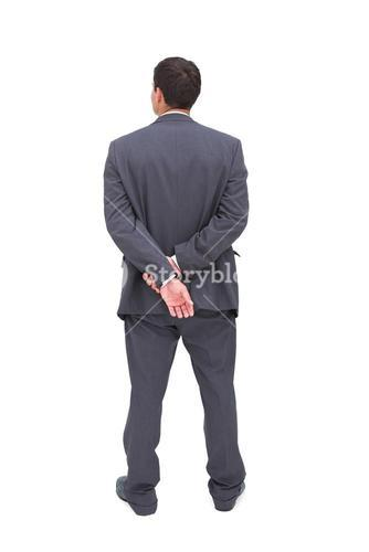 Rear view of classy businessman posing
