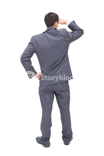 Rear view of young businessman looking away