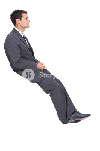 Classy young businessman sitting