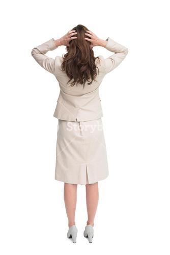 Businesswoman with hands on head standing back to camera
