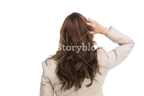 Rear view of classy businesswoman scratching her head