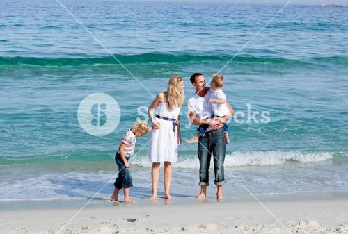 Animated family walking on the sand