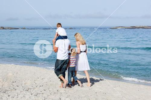 Affectionate family walking on the sand