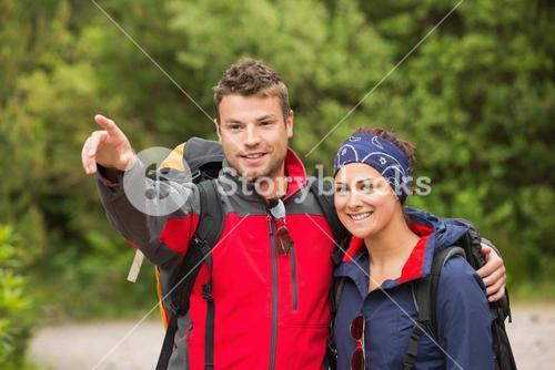 Smiling couple going on a hike together looking ahead