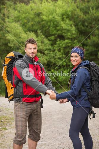 Loving couple going on hike together holding hands