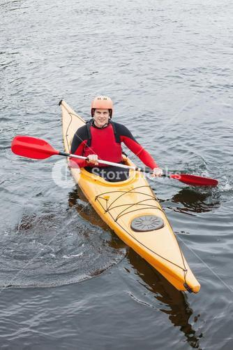 Happy man in a kayak