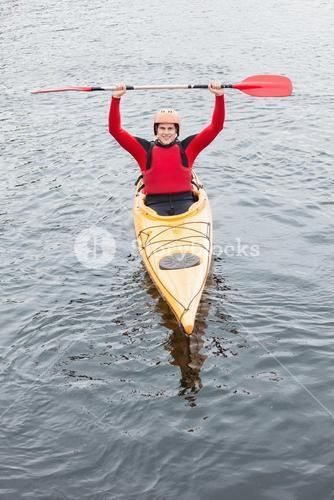 Happy man in a kayak cheering