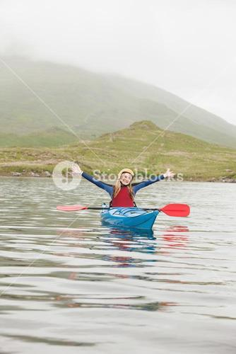 Blonde woman in a kayak
