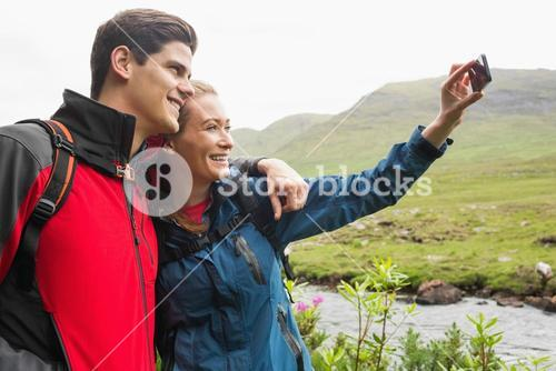 Athletic couple on a hike taking a selfie