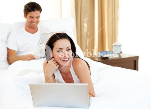Charismatic woman using laptop