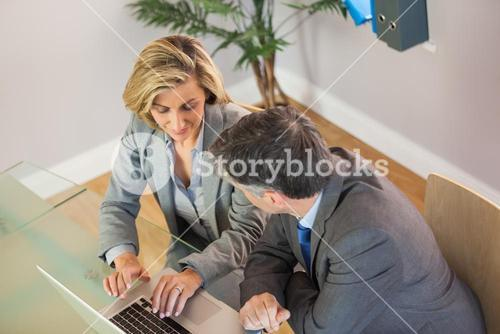 Business team going over work on the laptop