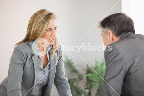 Colleagues arguing in an office