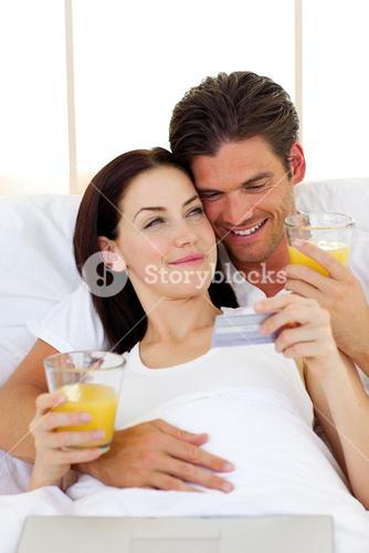 Intimate couple drinking orange juice