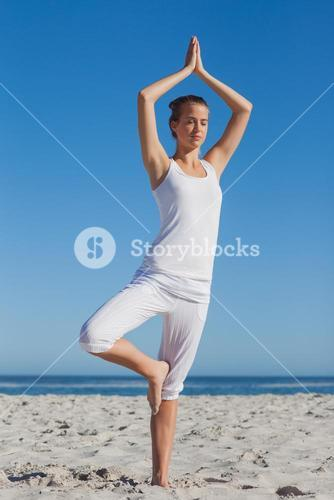 Woman in tree yoga pose