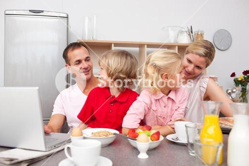 Lively family having breakfast together