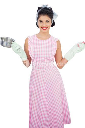 Pleased black hair model holding a pan and wearing rubber gloves