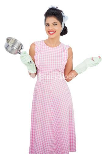 Joyful black hair model holding a pan and wearing rubber gloves