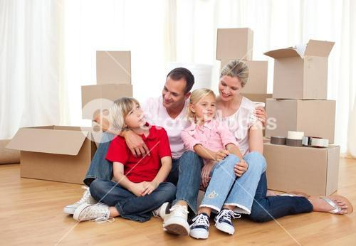 Tired family relaxing while moving house