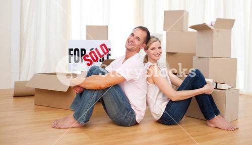 Smiling couple relaxing while moving