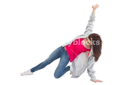 Pretty young woman making hip hop pose