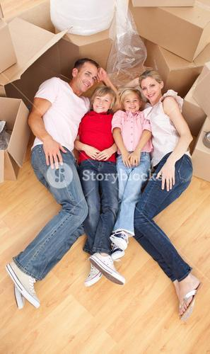 Smiling family while moving house
