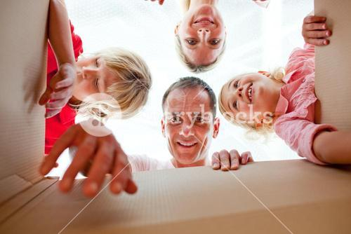 Cheerful family unpacking boxes