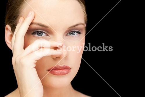 Glamorous young model posing hand on face