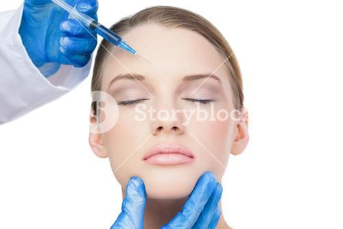 Content attractive model having botox injection on the forehead
