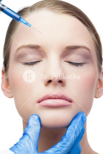 Peaceful attractive model having botox injection on the forehead