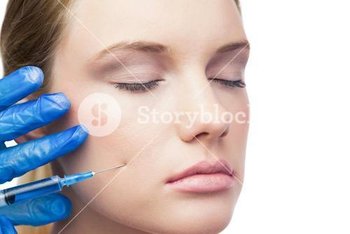 Peaceful cute model having botox injection on the cheek