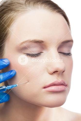 Calm cute model having botox injection on the cheek