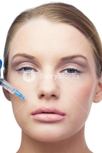 Content beautiful model having botox injection above the lips