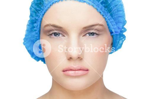 Content pretty model wearing blue surgical cap