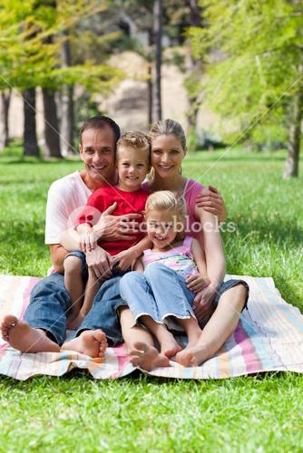 Portrait of a smiling family having a picnic