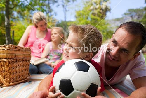 Happy family having fun at a picnic