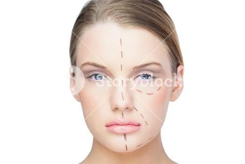 Peaceful pretty blonde with dotted lines on the face