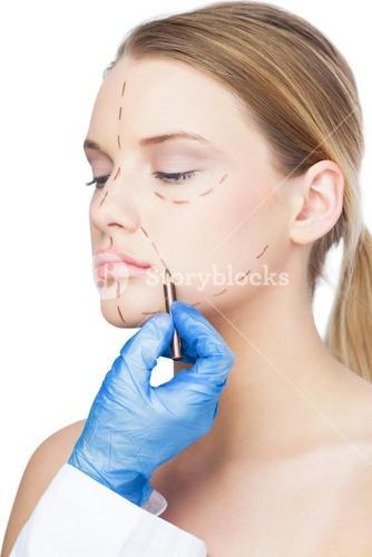 Surgeon drawing dotted lines on beautiful patient