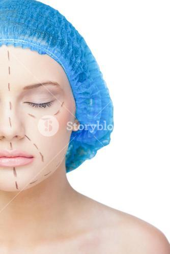 Relaxed young patient with dotted lines on the face