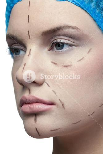 Close up on peaceful young patient with dotted lines on the face